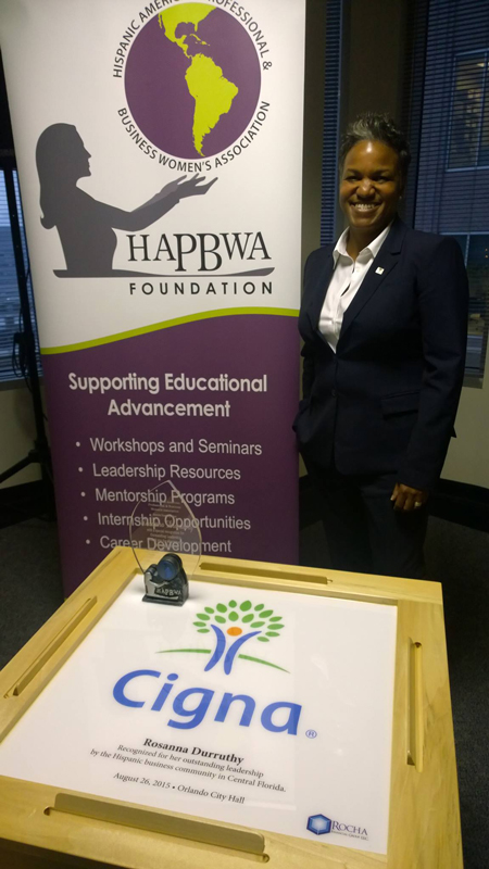 Rosanna Durruthy, Chief Diversity Officer of CIGNA, receives a special recognition from the Hispanic business community in Central FL with an Official DOMINO SAM table.